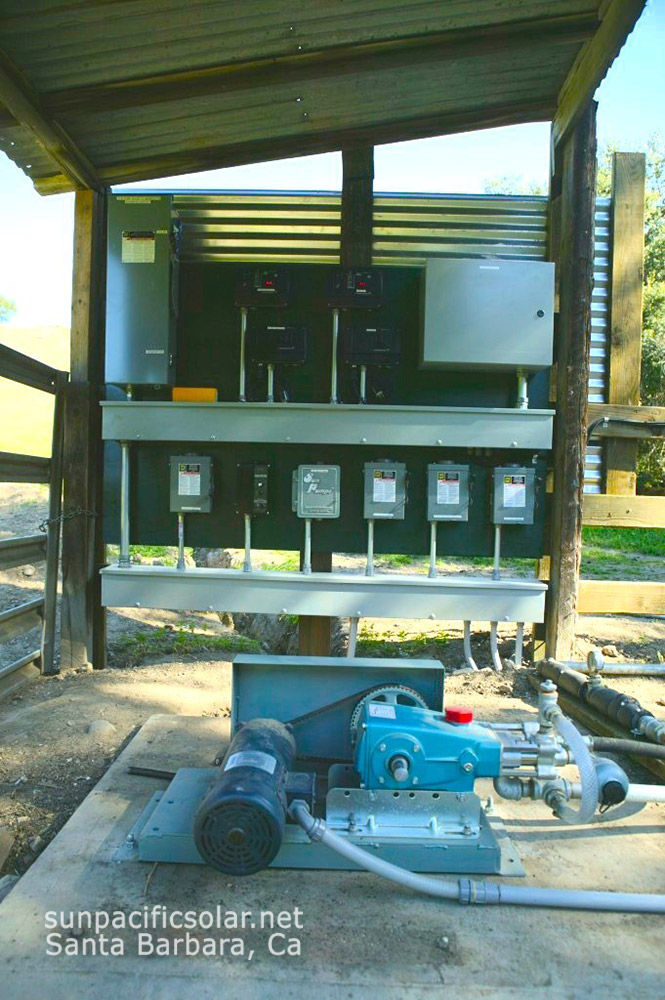 Three pumps, all solar-driven with generator backup to feed two cattle-watering tanks.