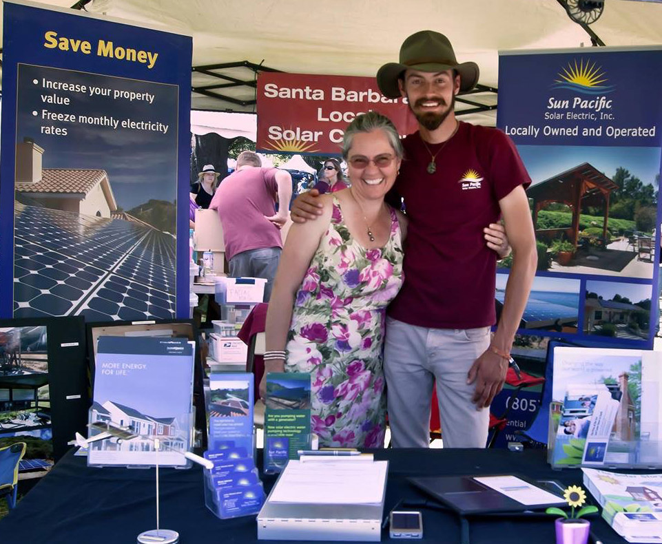 Cecilia and Wesly Johnson in the Sun Pacific Solar Electric booth at the Santa Barbara Earth Day celebration.