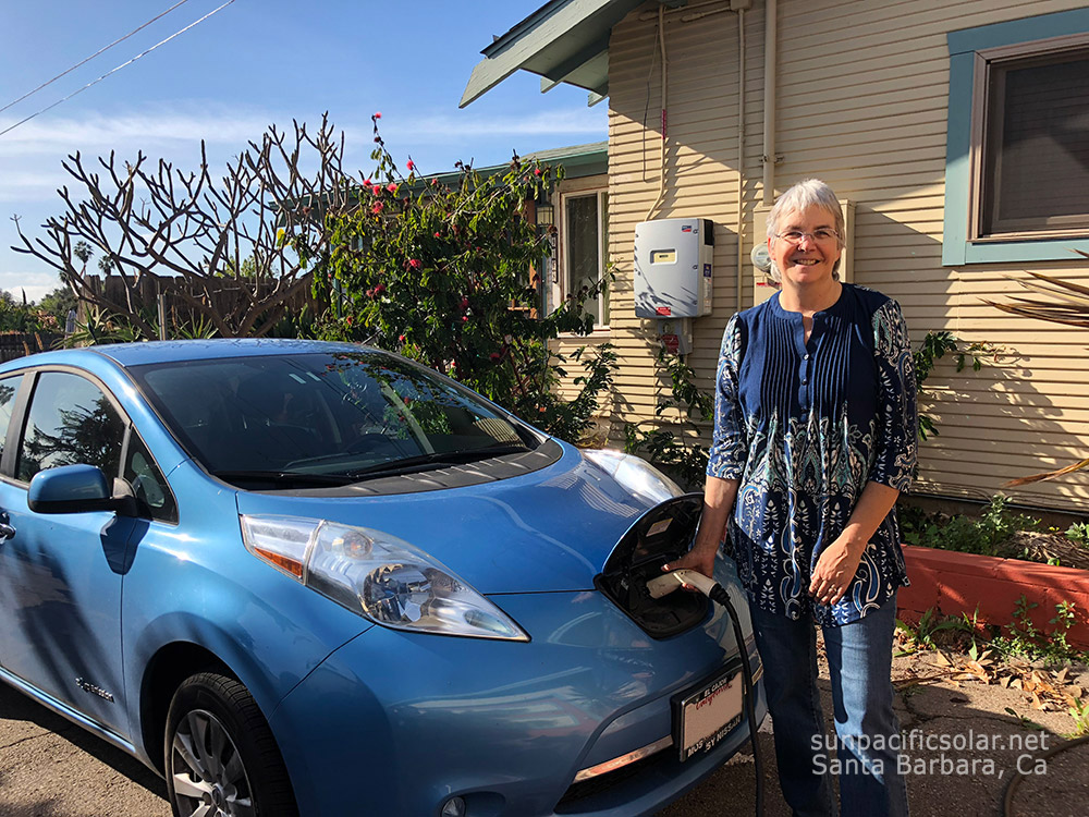 A happy customer with her new Electric Vehicle.
