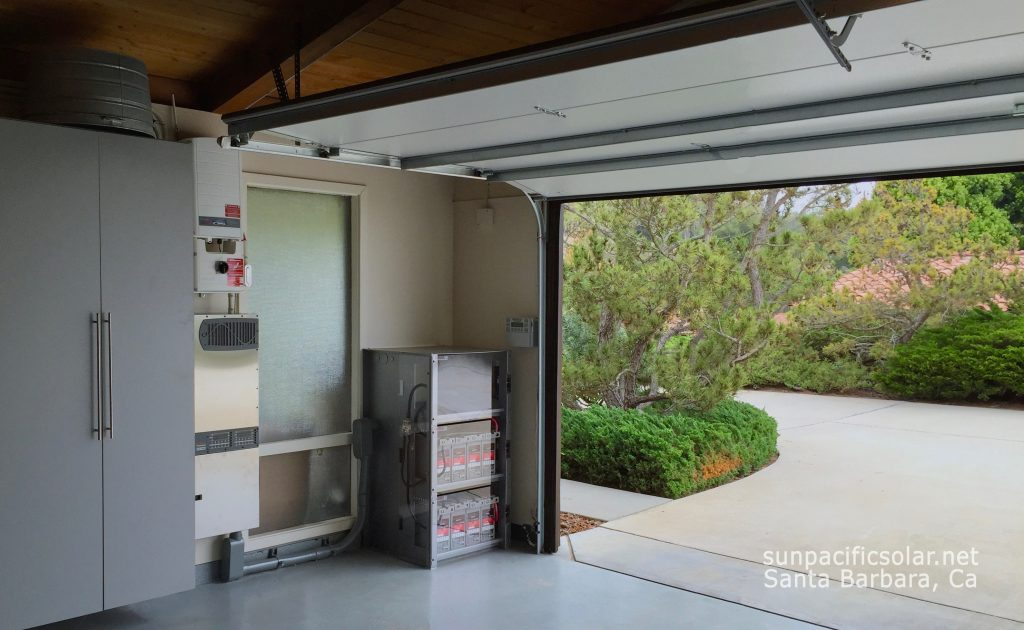 A home battery backup system neatly installed in the corner of a garage on the Santa Barbara Riviera.